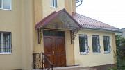 Жилой дом в Каменском на правом берегу водохранилища Кам'янське
