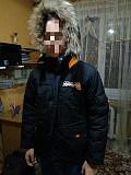 Продам б\у практичную , удобную зимнюю куртку DONILO с капюшоном Кривой Рог