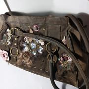 Кожаная сумка с интересным декором Олександрія