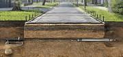 Прокол под дорогой в Херсоне для безтраншейного прокладывания комуникаций. Ливневая канализация. Херсон